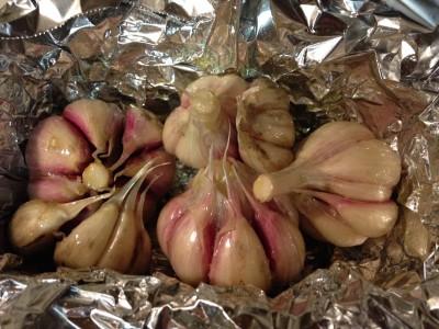 Oil garlic before roasting